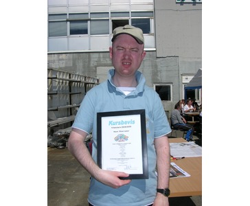Stian med diplom -smmeren 2009